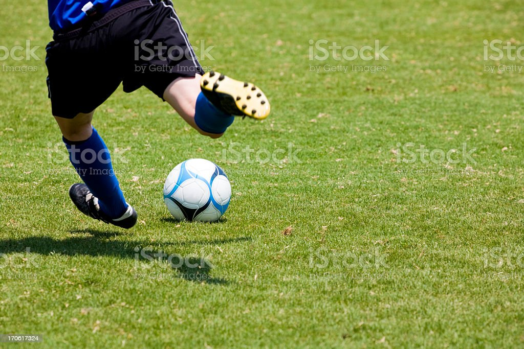 Close-up of soccer player's feet throwing a free kick royalty-free stock photo