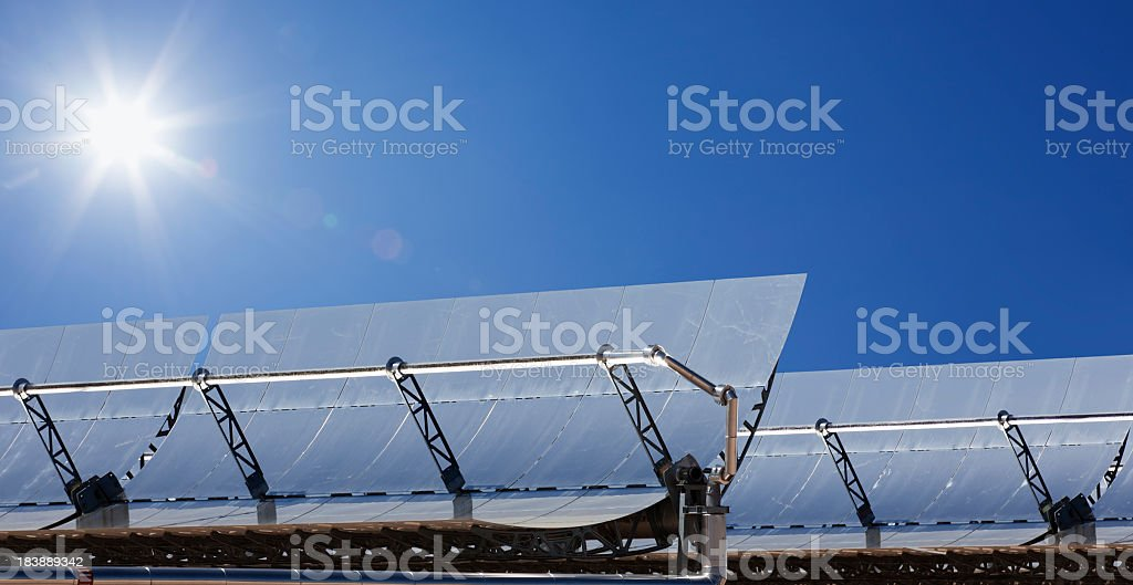 Close-up of solar power plant under blue sky stock photo