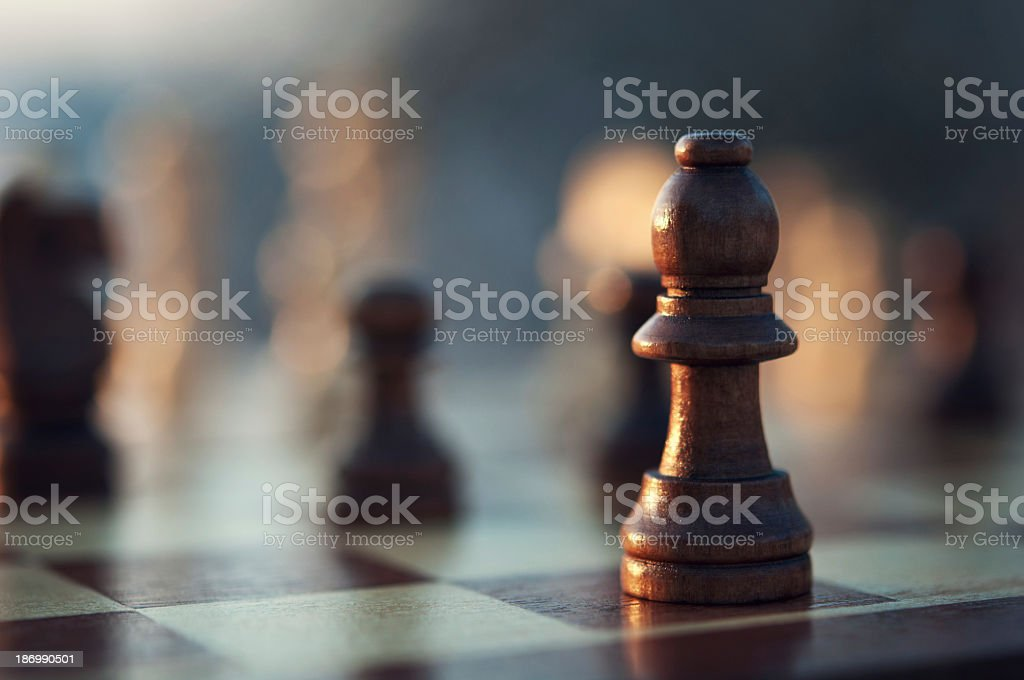 Close-up of some chess pieces on a chessboard stock photo