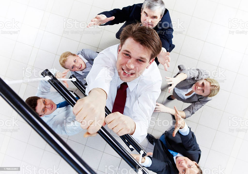 Close-up of someone climbing a ascending ladder stock photo