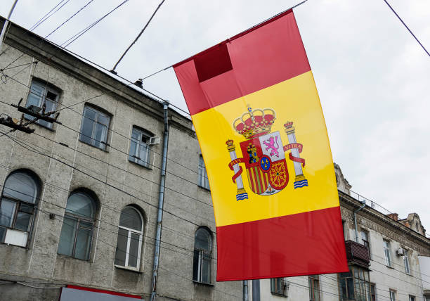 Close-up of Spain flag on old street background. stock photo