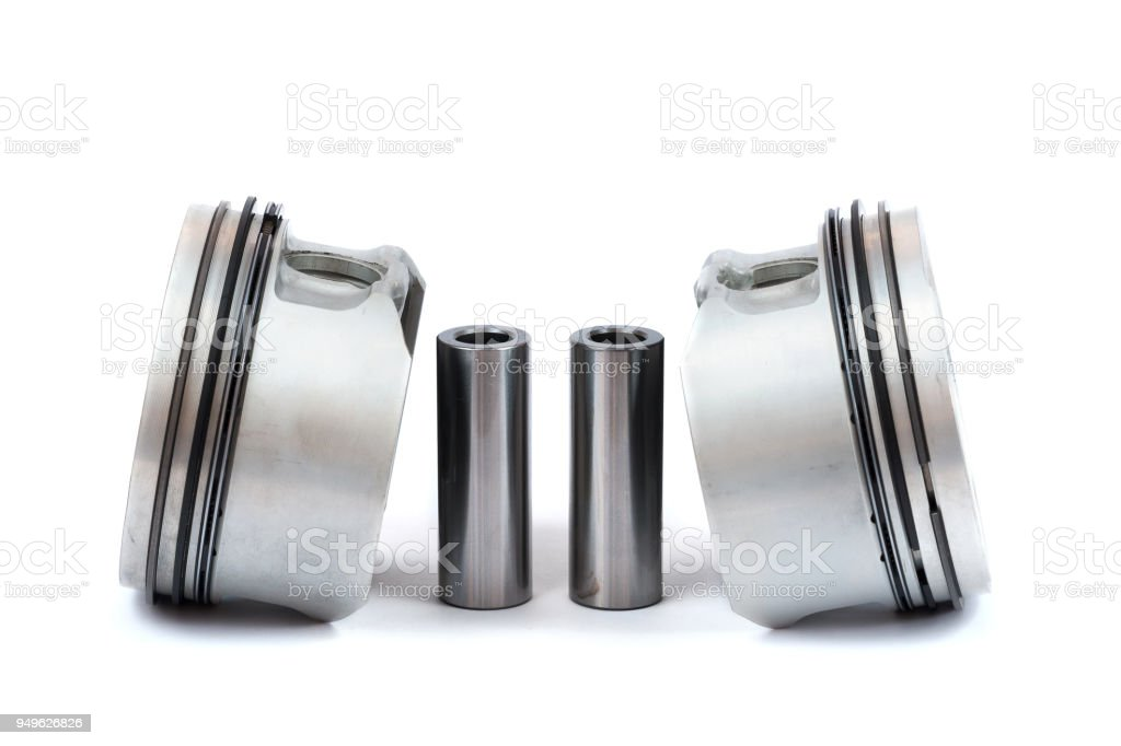 Close-up of spare parts two new pistons with connecting rods for a...