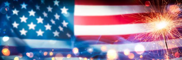close-up of sparkler with bokeh and smoke on american flag background - happy 4th of july zdjęcia i obrazy z banku zdjęć
