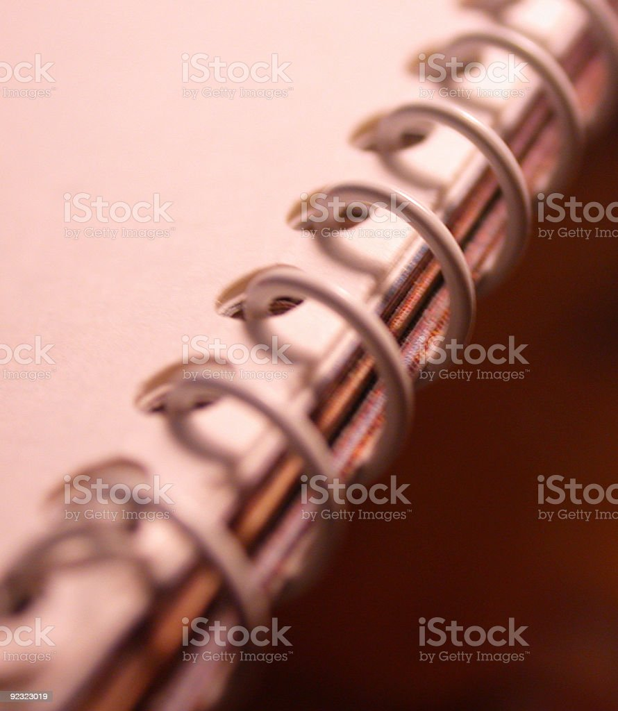 Closeup of spiral notebook with sepia hue and copy space royalty-free stock photo