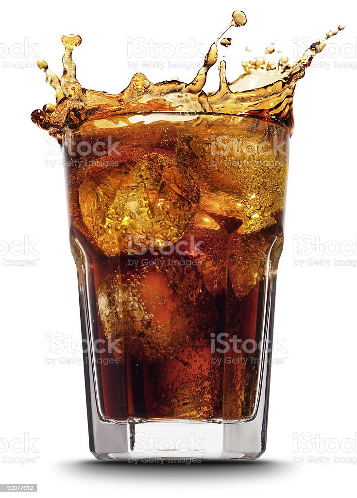 Close-up of splashing cola after adding ice cubes stock photo