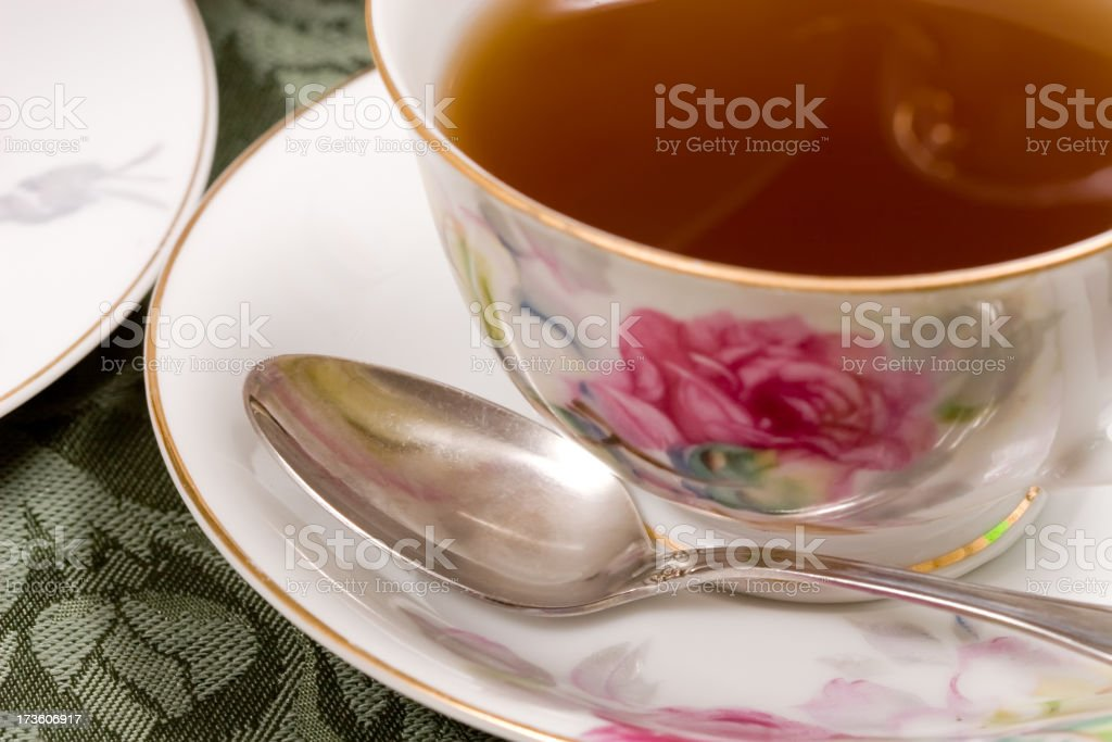 Closeup of spoon and teacup royalty-free stock photo