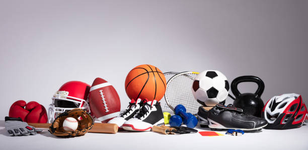 Close-up Of Sport Balls And Equipment Variety Of Sport Balls And Equipment In Front Of Gray Surface sport stock pictures, royalty-free photos & images