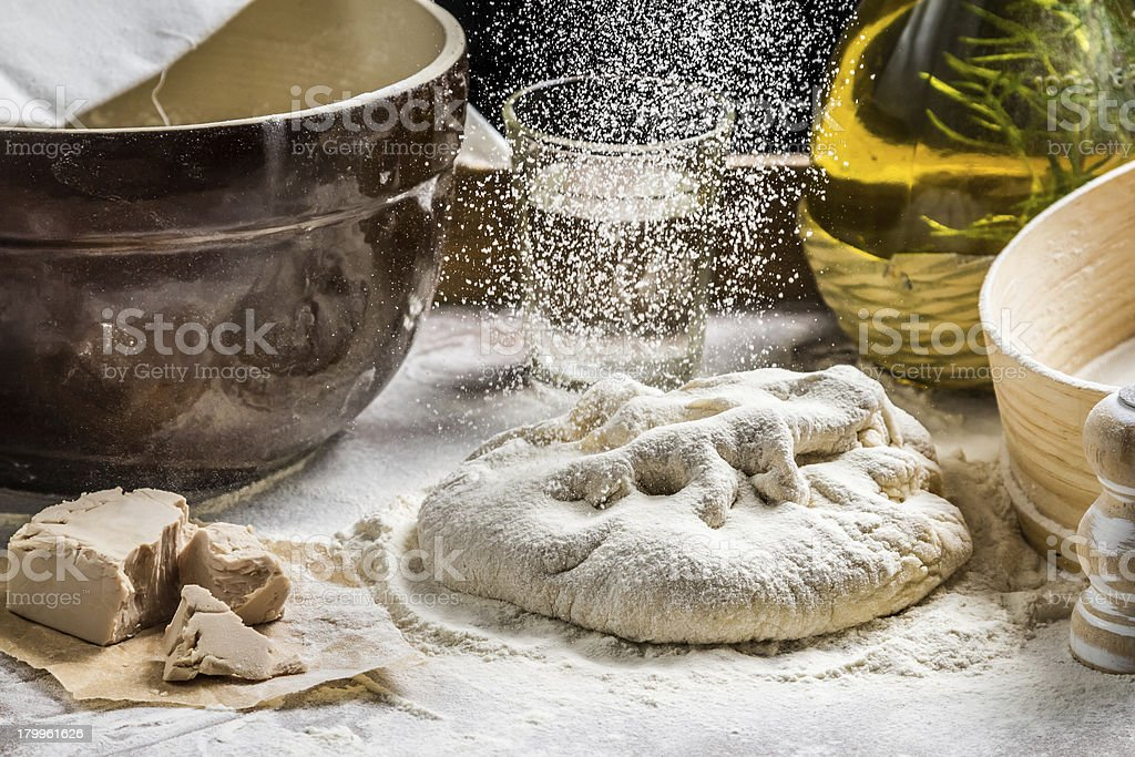 Closeup of sprinkling flour pizza dough royalty-free stock photo