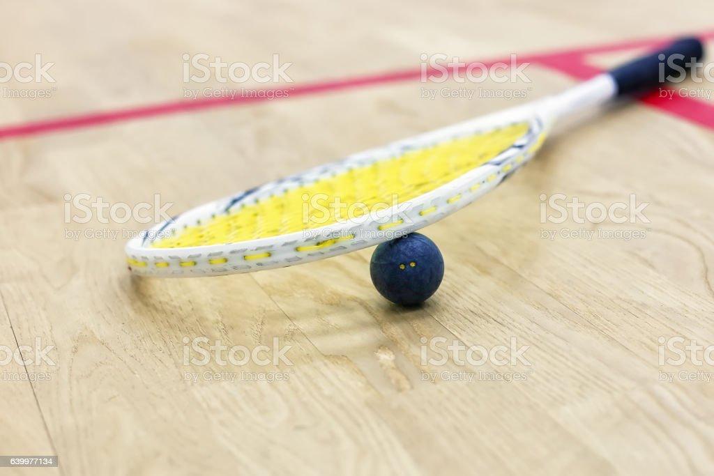 Closeup of squash racket and ball stock photo