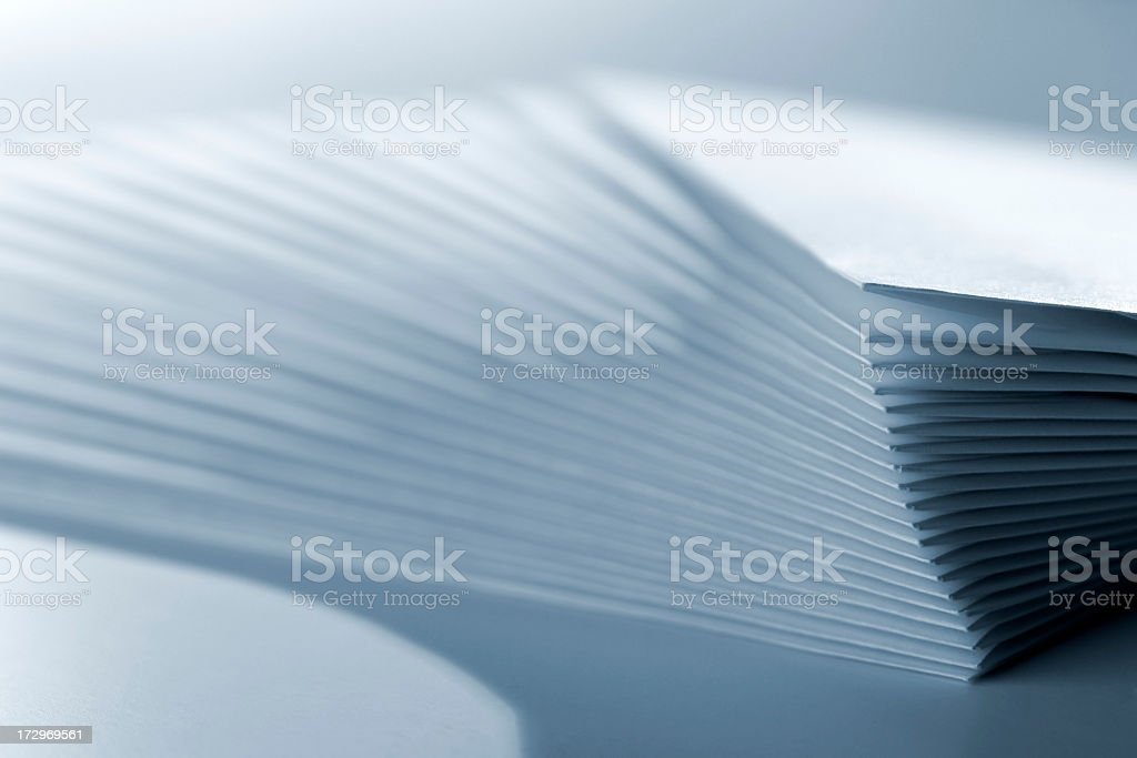 Close-up of stack of paper envelopes, blue toned stock photo