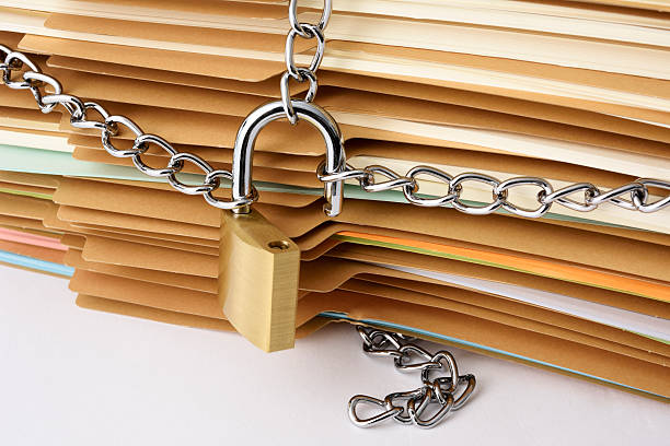 close-up of stacked brown file folder with unlocked padlock - goldgefüllte kette stock-fotos und bilder