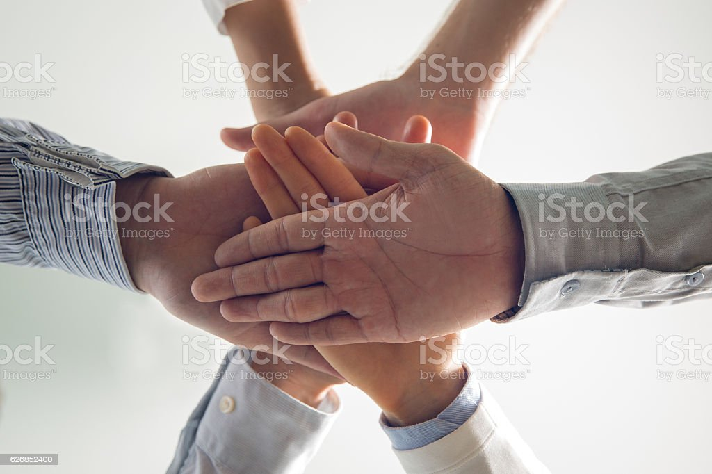 Close-up of stacked hands of business team stock photo