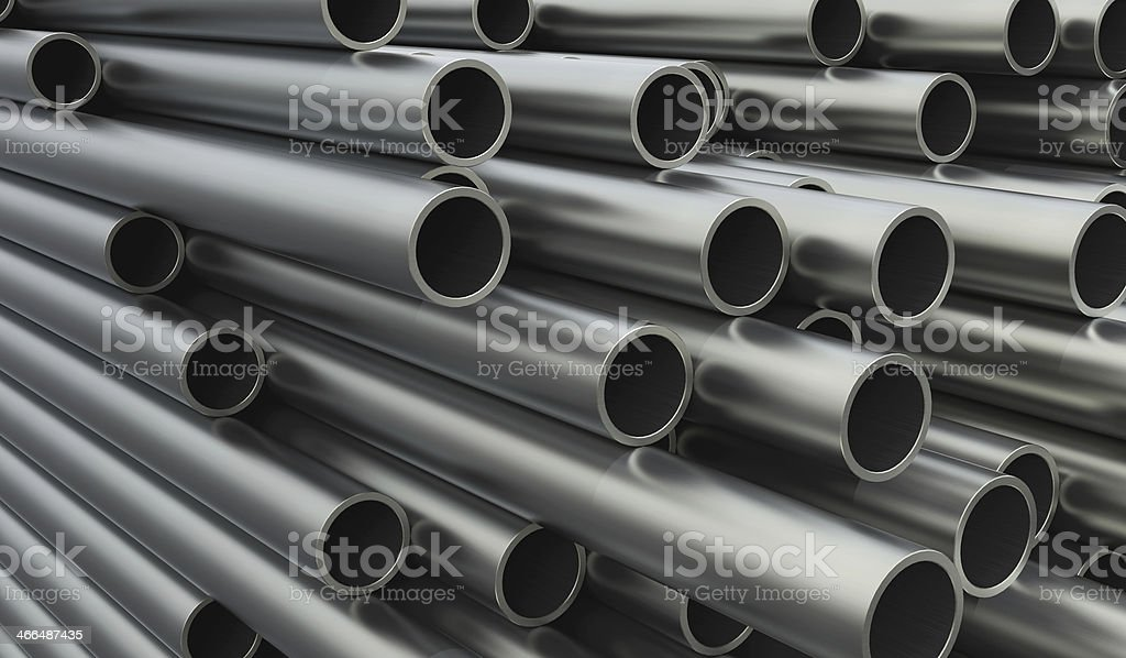 Close-up of stacked metal pipes of varying lengths stock photo