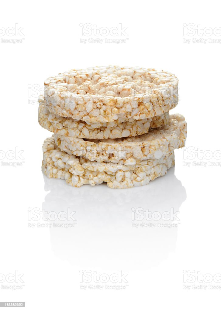 A closeup of stacked rice cakes on a white background stock photo