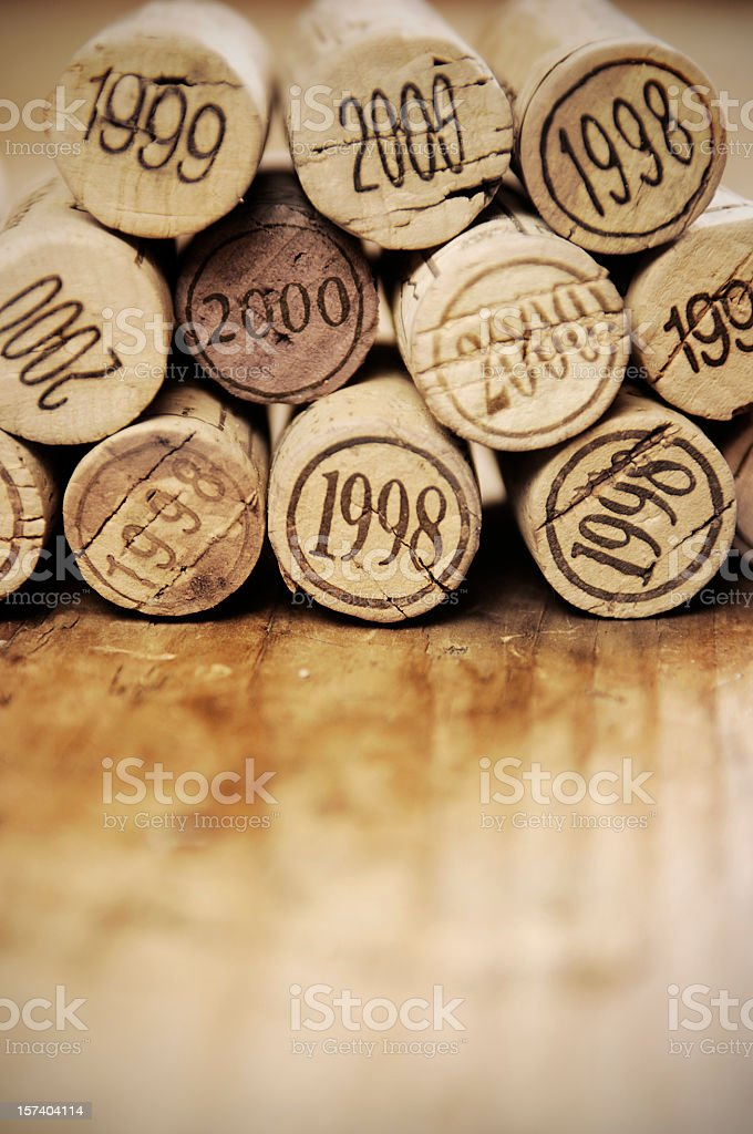 Close-up of stacked wooden corks with year numbers royalty-free stock photo