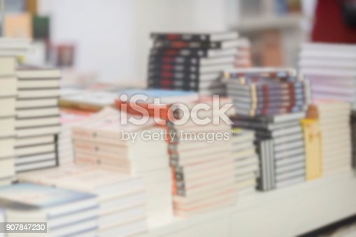 istock Close-up of stacks of books in multicolored bindings on light background. Concept of starting school, back to school, information, education 907847230