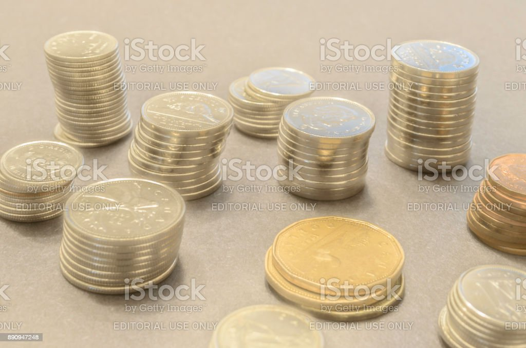 Closeup of stacks of coins in a mystical setting with a golden hue stock photo