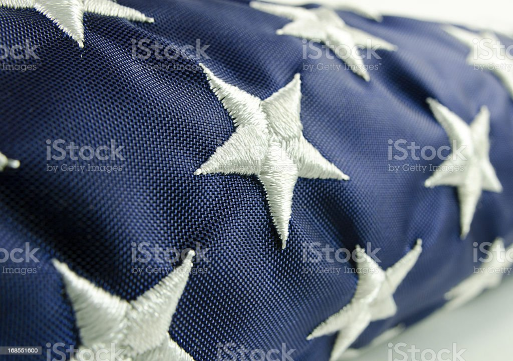 Close-up of stars on a folded American flag stock photo