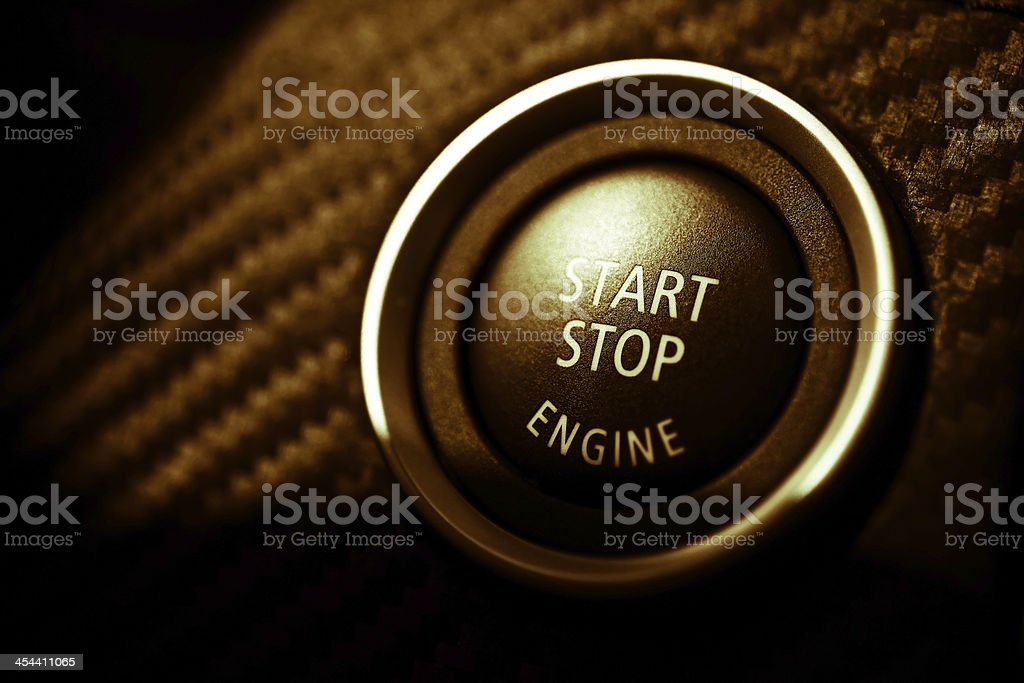 Close-up of start stop button for an engine royalty-free stock photo