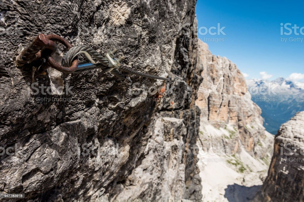 Closeup of steel cable of via ferrata route. stock photo