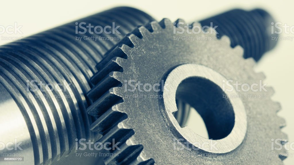 Close-up of steel gearwheel and shaft with thread stock photo