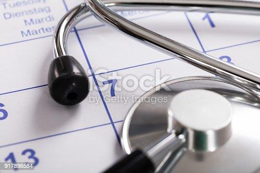 Close-up Of Medical Equipment Stethoscope Over Calendar