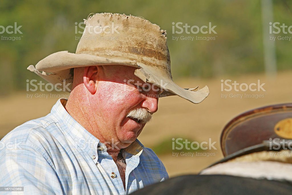 Close-up of stockman out in harsh sun stock photo