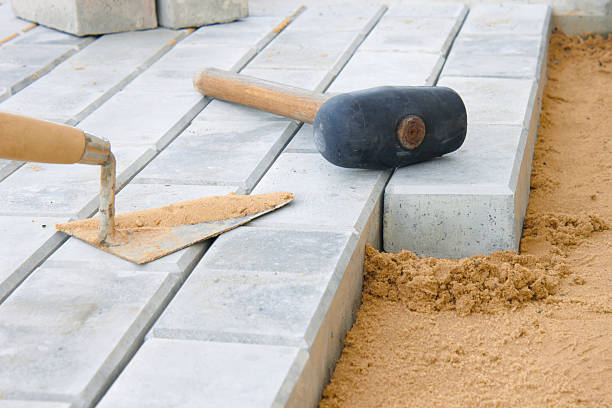 Close-up of stone paving tools of scraper and hammer stock photo