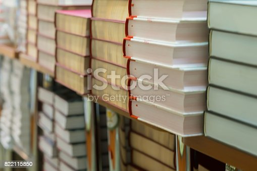 istock Close-up of stops of books, textbooks or fiction in book store, in library. Education, school, study, reading fiction concept. Abstract blurred background 822115850