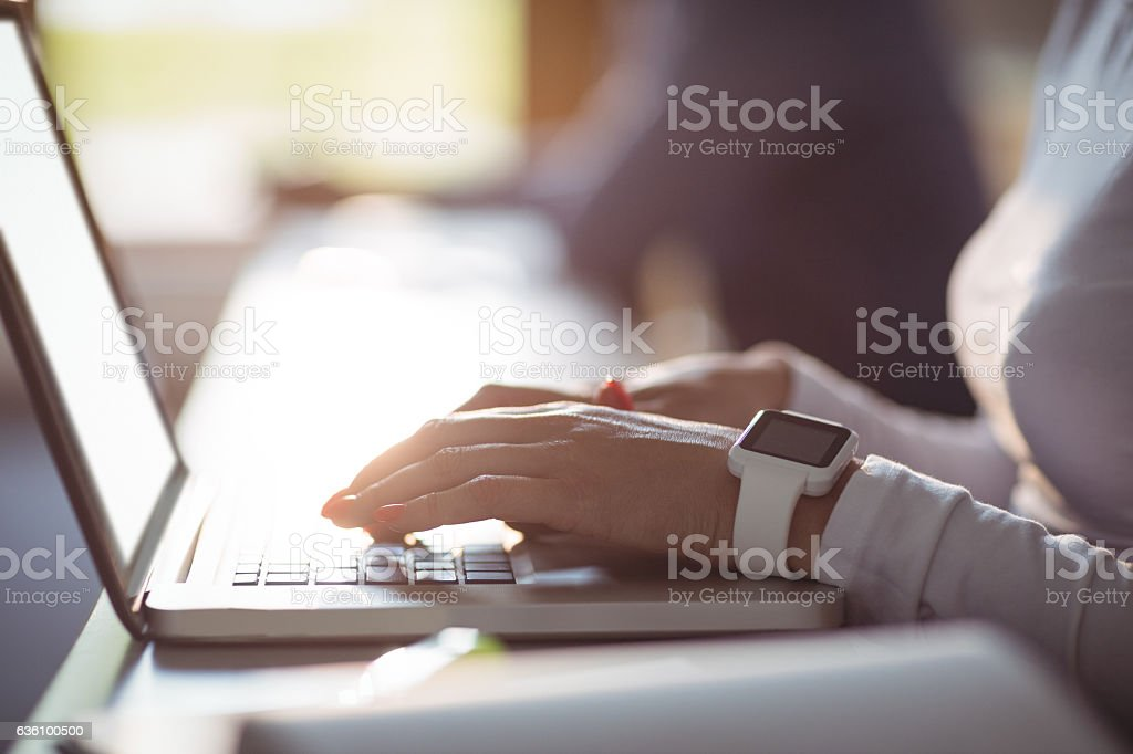 Close-up of student using laptop stock photo
