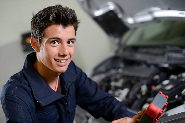 Closeup of student working in garage stock photo