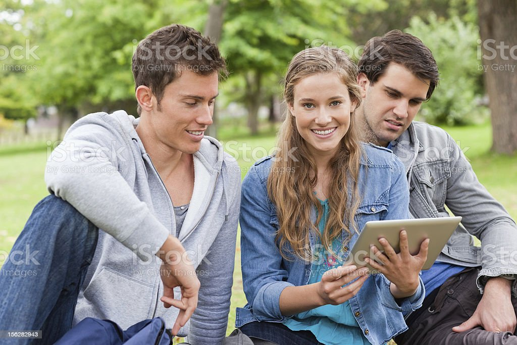 Close-up of students watching videos on a touch pad royalty-free stock photo