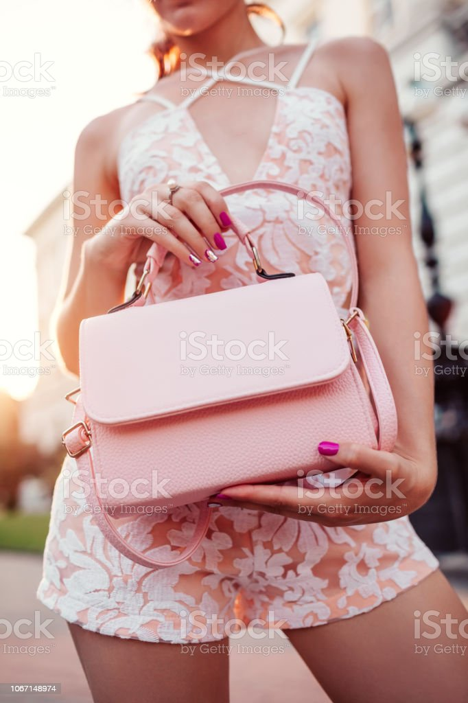eeb8b5a8 Close-up of stylish female handbag. Fashionable woman holding beautiful  accessory and wearing sexy