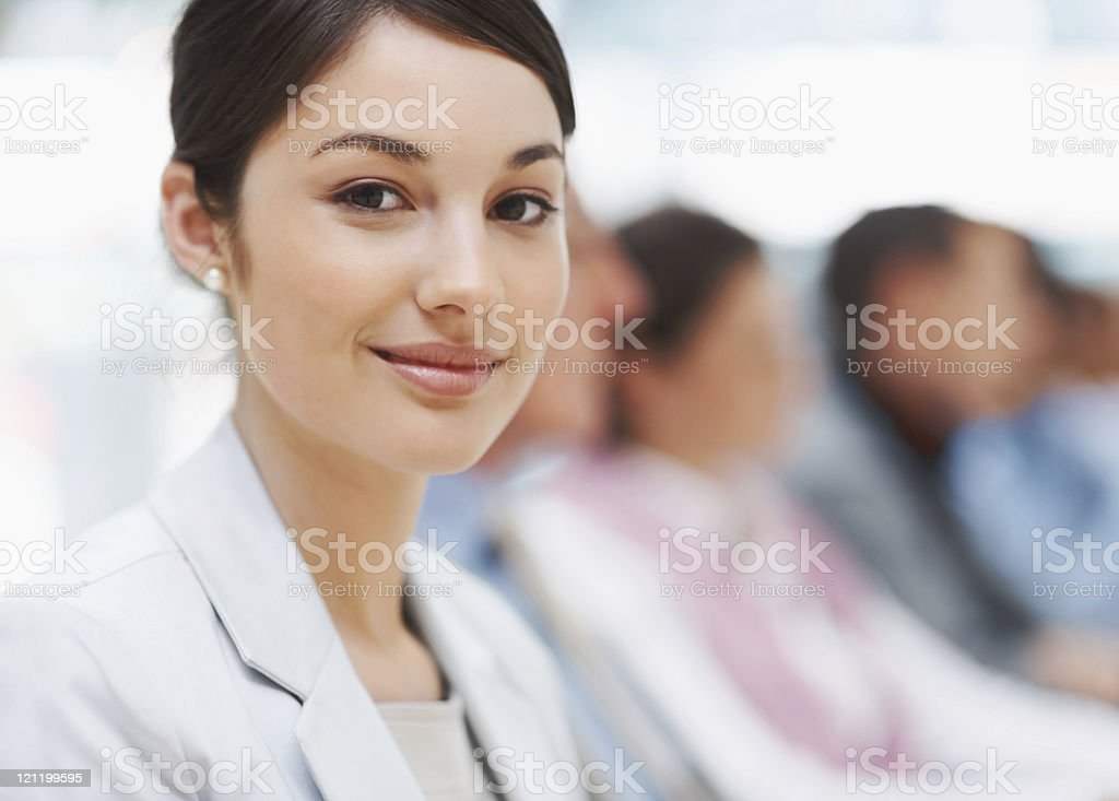 Closeup of successful young businesswoman at a conference royalty-free stock photo