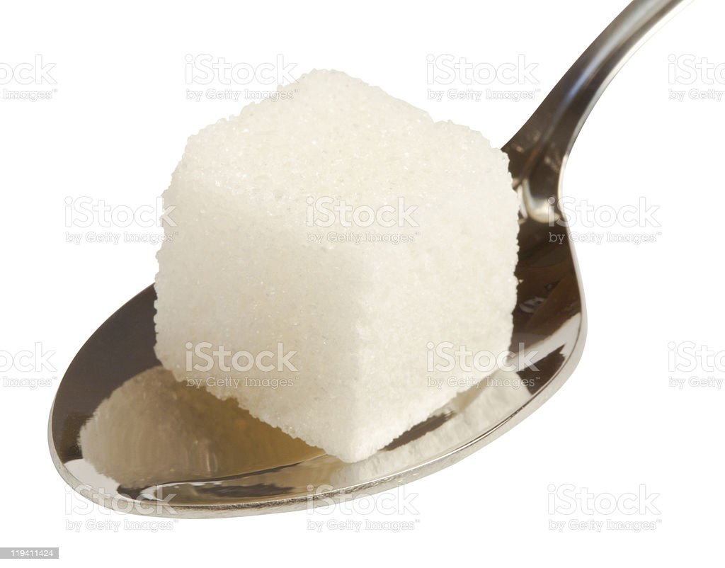 Close-up of sugar cube on a silver spoon stock photo