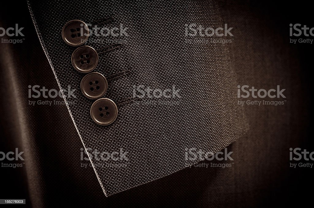 Close-up of suit's sleeve and buttons in brown colour stock photo