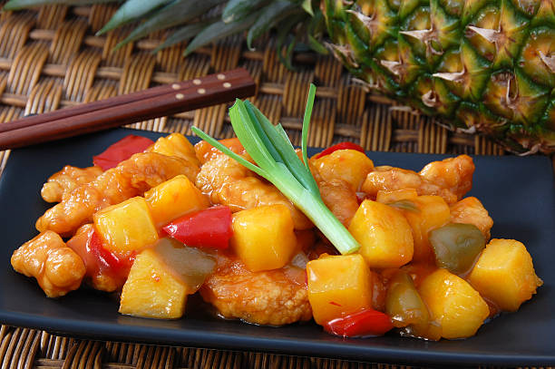 Close-up of sweet and sour chicken with pineapples stock photo
