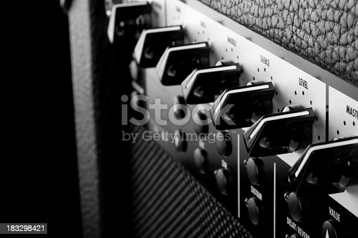 istock Close-up of switches on music amplifier 183298421
