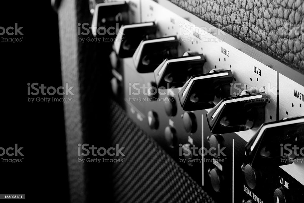 Close-up of switches on music amplifier stock photo