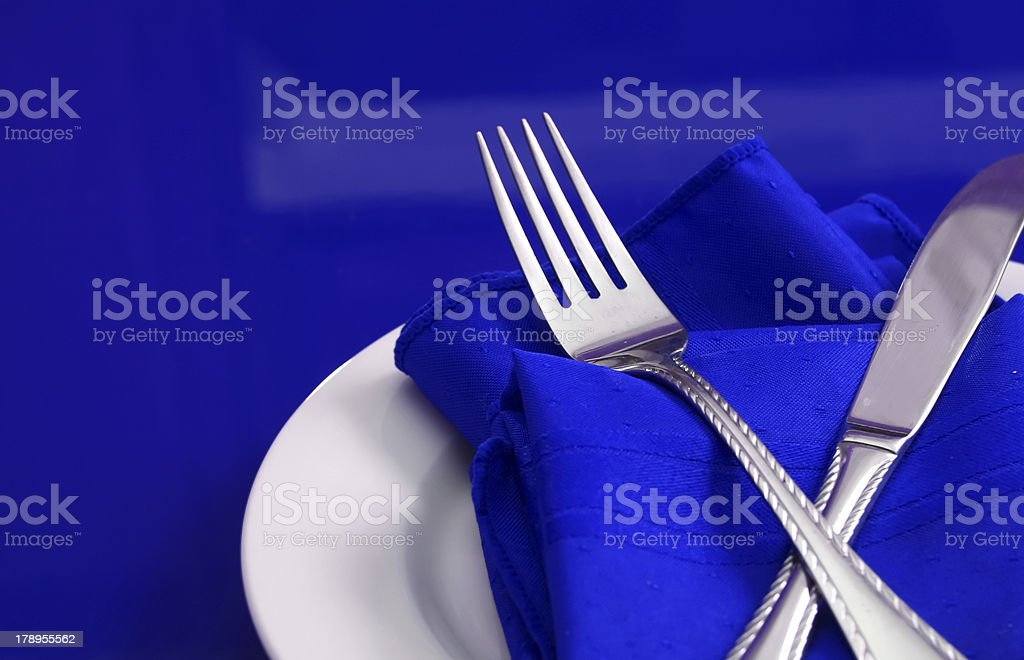 Closeup of table setting in blue royalty-free stock photo