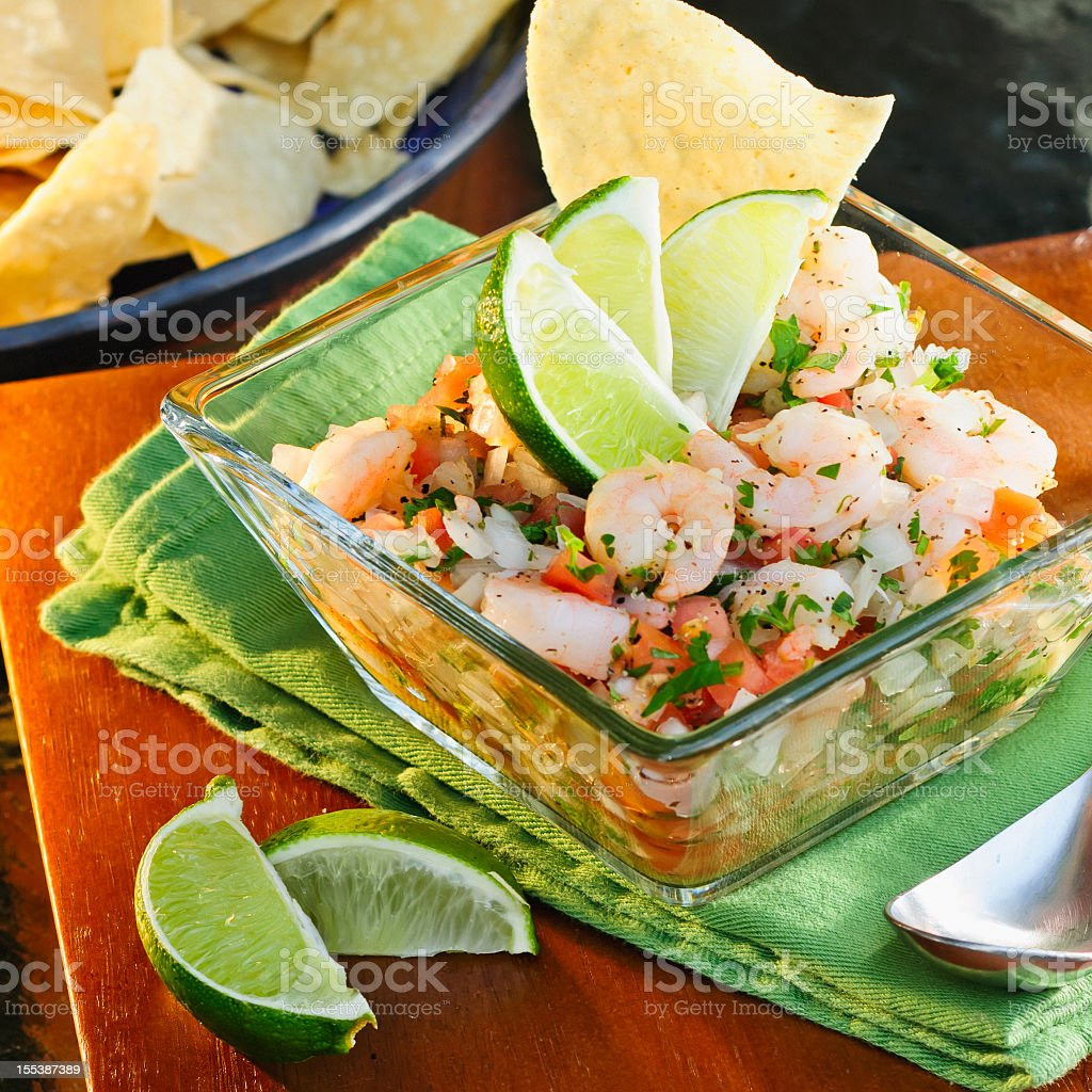 Close-up of tasty Ceviche cured with lime wedges stock photo