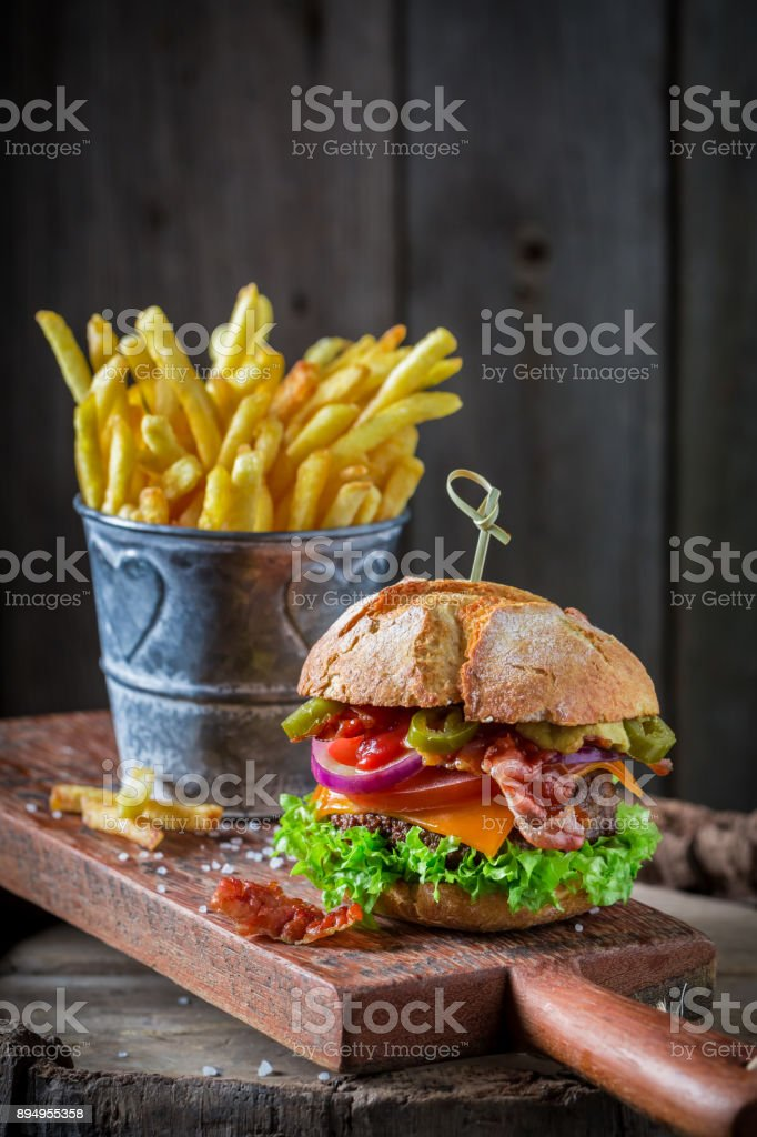 Closeup of tasty hamburger made of lettuce, beef and cheese stock photo