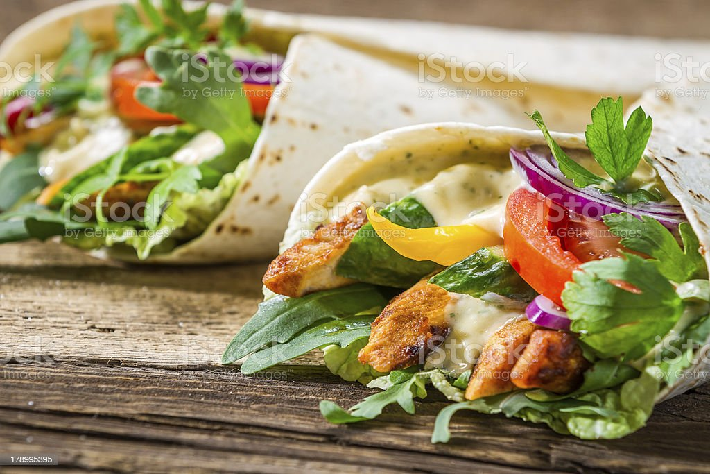 Closeup of tasty kebab with vegetables and chicken stock photo