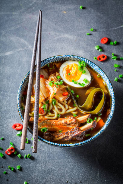 Closeup of tasty Kimchi soup with chive and noodles Closeup of tasty Kimchi soup with chive and noodles kimchee stock pictures, royalty-free photos & images