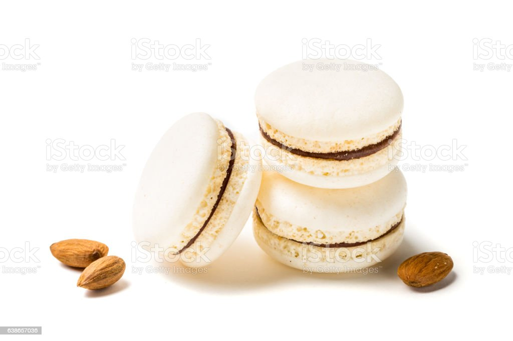 Closeup of tasty macaroons with almond on white background stock photo