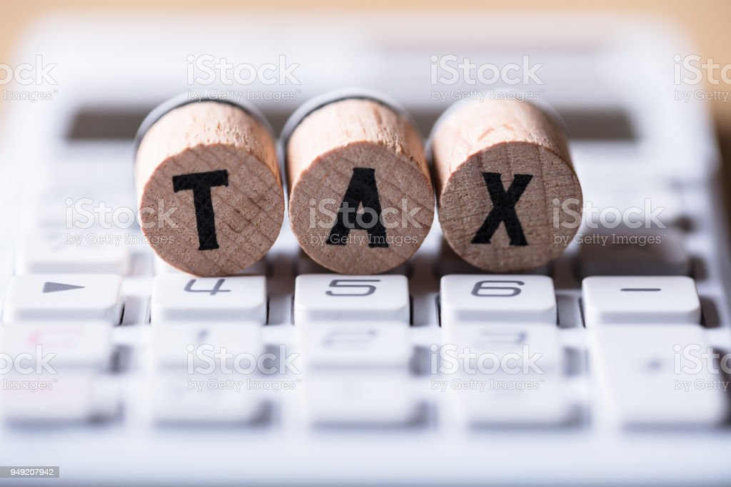 Close-up Of Tax Text On Cork stock photo