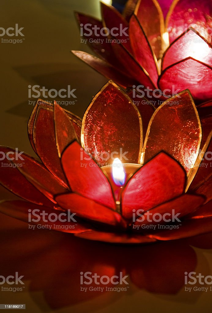 Close-up of Tealights Burning in Holders, Low Key royalty-free stock photo