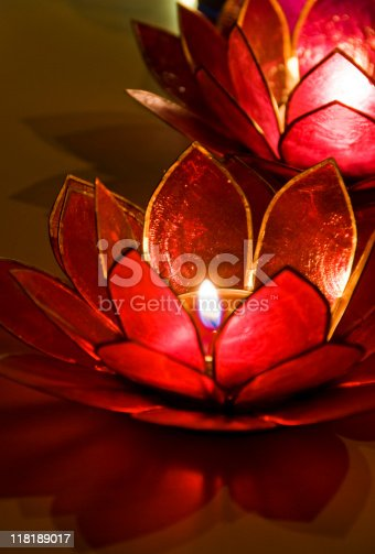 Burning tealights in a lotus shaped candle holder.