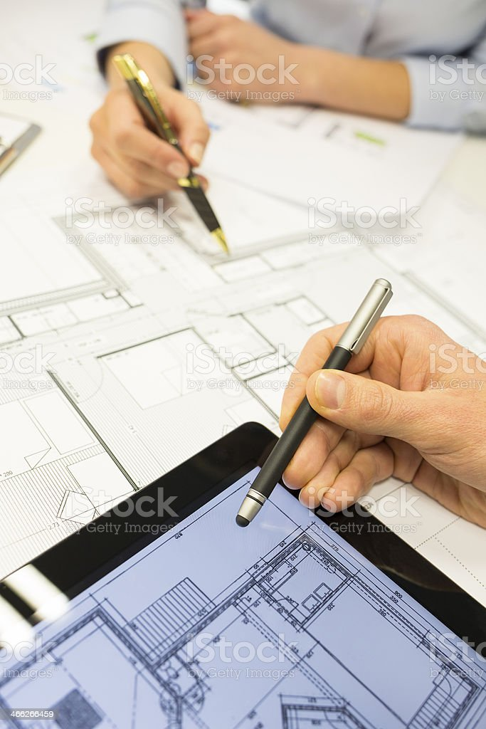 Close-up of Team architects working on construction project at office stock photo