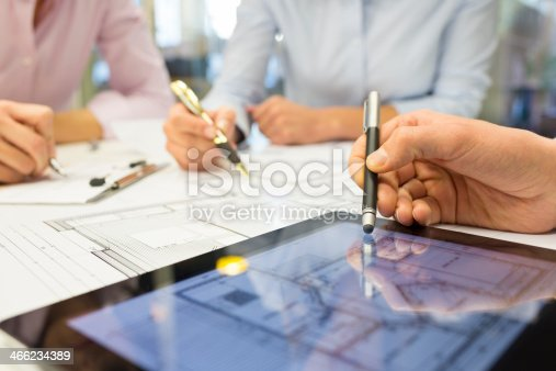 istock Close-up of Team architects working on construction project in o 466234389